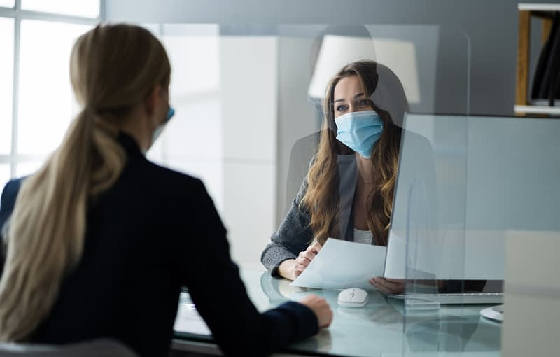Insurance Consultant Or Lawyer In Bank With Sneeze Guard And Mask